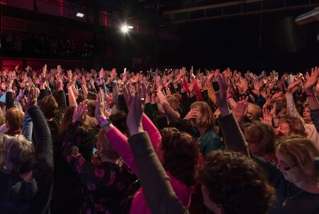 Eindhoven,netherlands,26-jan-2019:people with hands up having fun while listening to the music on stage during a concert,this is a annual concert with different artists