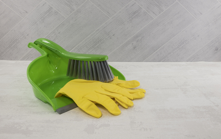 dustpan and golves in green and yellow