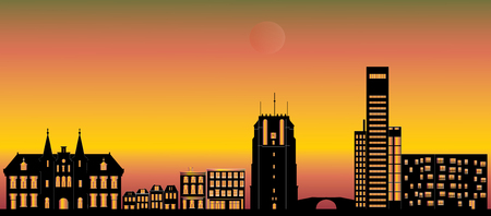 the city skyline of leeuwarden with landmarks like the church and the blokhuispoort and the campus during sunset