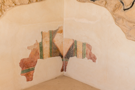 leftovers of old wall paintings at the ruins of the ancient Masada fortress in Israel,build by Herod the great