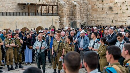 Jerusalem,israel,26-march-2019: group of soldiers pray at the western wall in jerusalem on sabbat evening