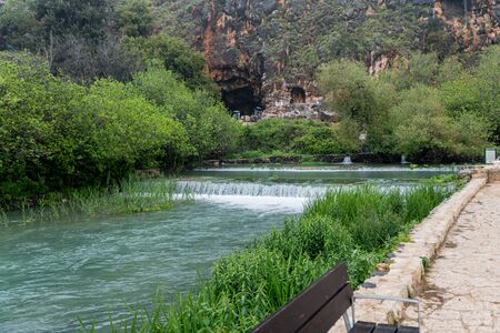 In the background of the Banias Spring is Pans Cave, where the waterway originated in ancient times Stock Photo