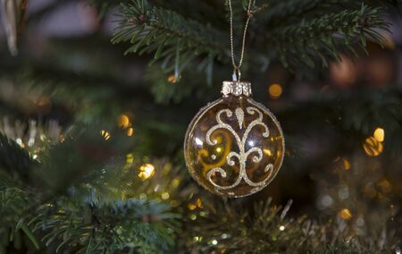 golden christmas ball in the tree as a christmas card during the december season Stock Photo