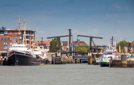 Maassluis,Holland,19-aug-2020: Town of Maassluis seen from the Nieuwe Waterweg with the bridge