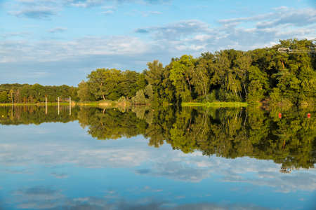 reflection of the trees in the lake of national park  in Holland, this is in summer a place to swim and water sport Banco de Imagens