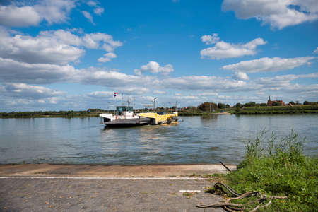 BergenHolland,10-sep-2020:ferry across the river Maas from vlieringsbeek to bergen, it is used by cars and bike to enter the maasduinen nature park