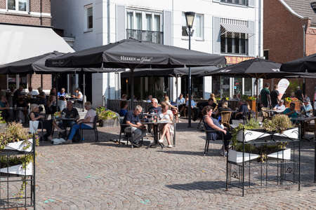 Gemert,Netherlands,13-sep-2020: People enjoy drinks on a cafe terrace on the Grote Markt square in the center of Gemert