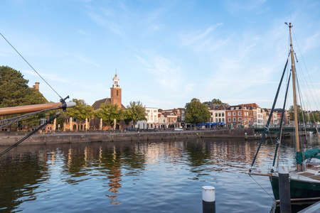 city view with harbour and church Vestingkerk in Hellevoetsluis at dusk, South Holland, Netherlands Editorial