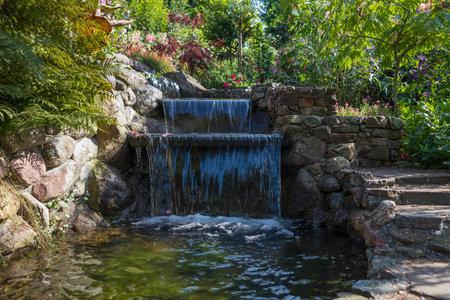 flowers and waterfall in a garden in holland Foto de archivo