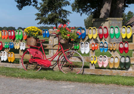 baskets with flowers and wooden shoes in holland Foto de archivo