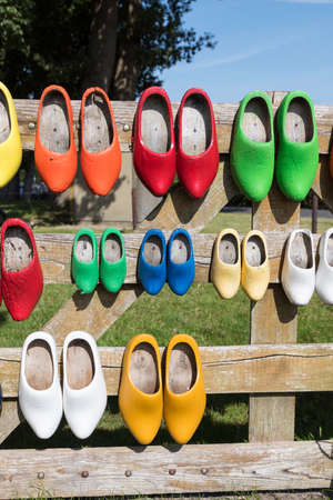 farm with diffferent wooden shoes at a wooden fence Foto de archivo