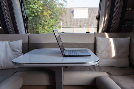 laptop computer ready to internet from inside a caravan