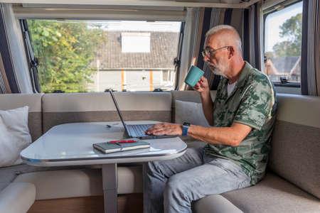 working from home form inside a caravan Foto de archivo