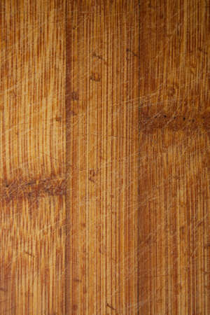 Bamboo Wooden Board Rugged With A Knife Closeup
