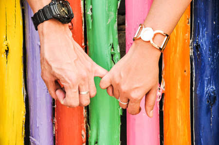 hand in hand with colorful bamboo background Stock Photo - 14565522