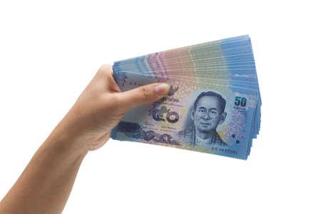 Hand holding thai money on white background photo