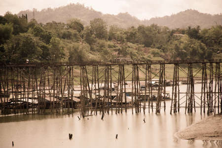 Mon wood bridge, across river , songkalia river, Sangkhlaburi Kanchanaburi, Thailand photo