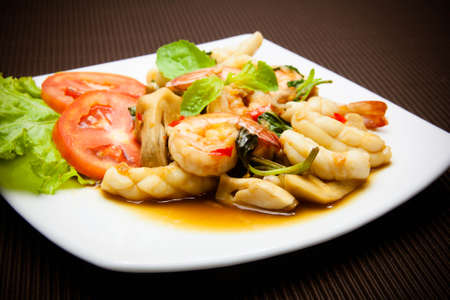 thai basil: Spicy fried squid and shrimp with basil leaves Thai food