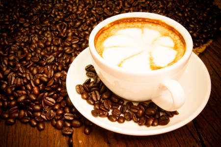 cafe latte: Coffee cup and saucer on a wooden table Stock Photo
