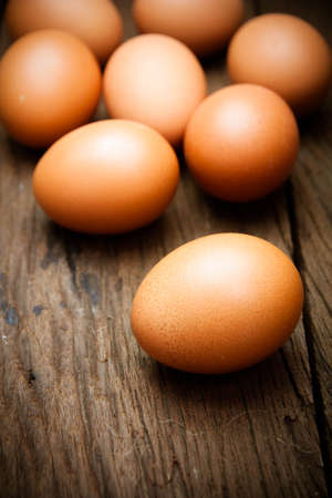 eggs on wood background photo