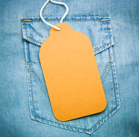 Denim texture with paper jeans label photo