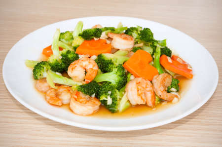 Shrimp stir-fried broccoli with carrot, Thai food Stock Photo
