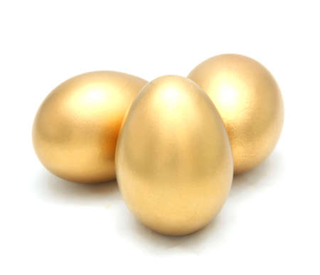 Golden egg isolated on white background photo