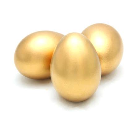 Golden egg isolated on white background photo