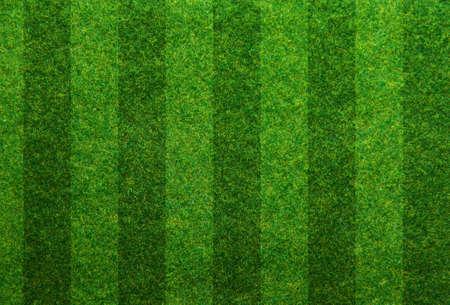 La hierba verde de fondo del campo de fútbol