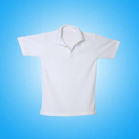 White polo shirt on blue background photo