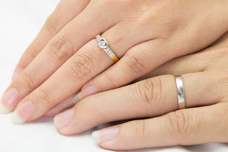 Hands of man and woman with ring photo
