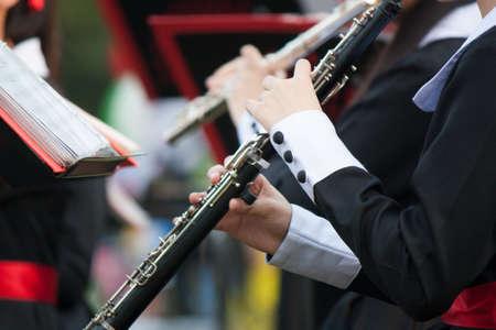 clarinet: Manos de mujer tocando un clarinete Foto de archivo