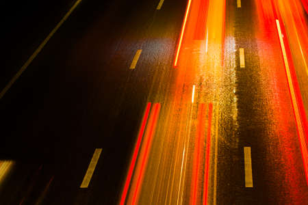 highway at night: Light trails on the road Stock Photo