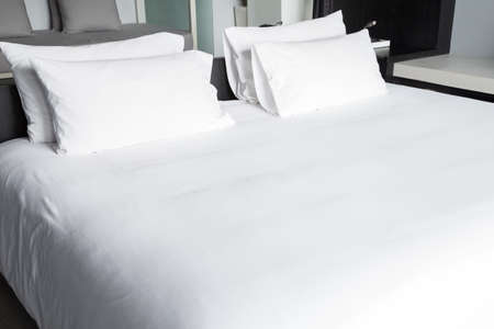 bed sheets: White bed sheets and pillows Stock Photo