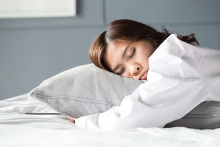 cushions: Asian woman sleeping on bed