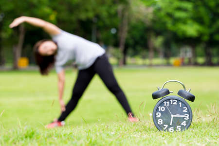 Morning  exercise and black clock Stock Photo