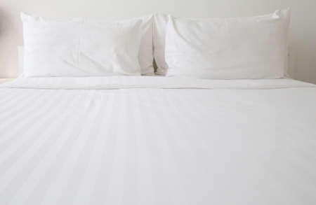 White bed sheets and pillows Banco de Imagens - 39062136