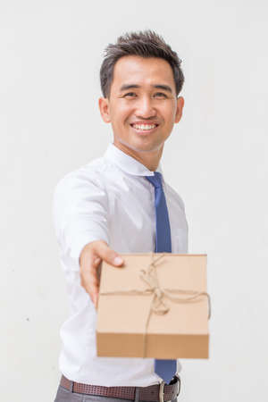 birthday suit: Businessman offering a gift Stock Photo