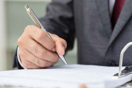 paper work: Businessman signing a document Stock Photo