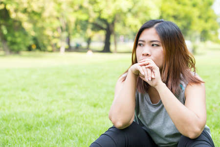 sad lady: Asian women unhappy in the park