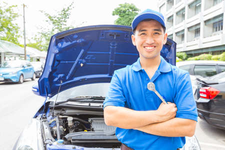Mechanic man with tool for repair car. Auto repair service Stock Photo