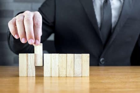job recruitment: Businessman choosing the wood block, Recruitment concept Stock Photo