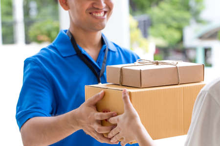 deliveryman: Woman hand accepting a delivery of boxes from deliveryman