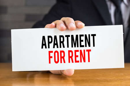 apartment for rent: Apartment for rent, message on white card and hold by  businessman