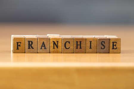 franchising: Franchise. word written on wood block Stock Photo
