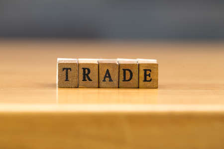 wood trade: Trade. word written on wood block