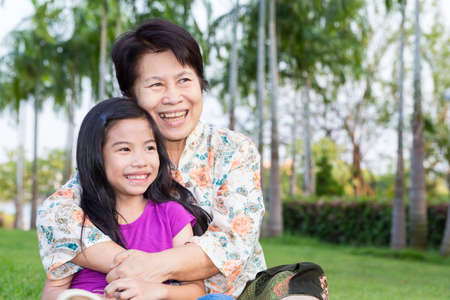 Happy asian grandma and grandchild smiling
