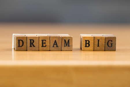 wood block: Dream big. word written on wood block Stock Photo