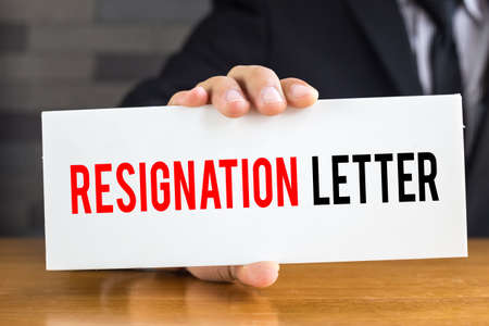 resignation: Resignation letter, message on white card and hold by businessman