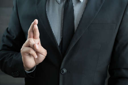 dishonesty: Dishonesty, Business fraud concept, Businessman showing fingers crossed